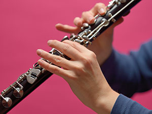 playing a clarinet